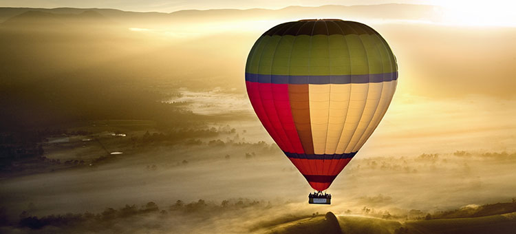 Global Ballooning' unbranded colour balloon on it's second flight in Victoria's Yarra Valley. Pilot, Brian Garth.